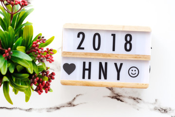 2018 happy new year on wood box on white marble table background, 2018 new year greeting card banner