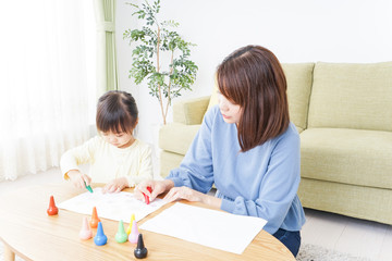 Mother and child making pictures