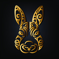 Golden rabbit head isolated on black background. Stylized Maori face tattoo. Golden bunny mask. Symbol of Chinese Horoscope by years. Vector illustration.