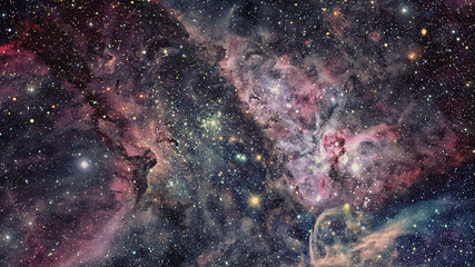 Night sky with nebula and stars. Elements of this image furnished by NASA.