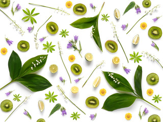 Fototapete - Composition pattern from plants, kiwi, lily of the valley  isolated on white background, flat lay, top view. The concept of summer, spring, Mother's Day, March 8.