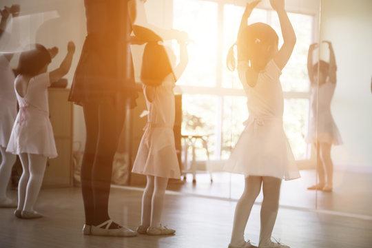 asian kid practice ballet dancing to balance body activities with trainer classic activities for kids