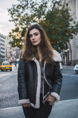 Stylish woman posing on street