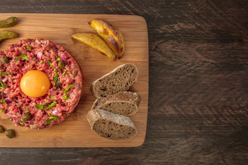 Steak tartare closeup with garnish and place for text