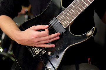 In rock bands, the main and necessary string instrument is usually an electric guitar.