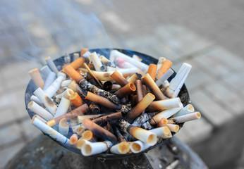 Cigarette butts at ashtray