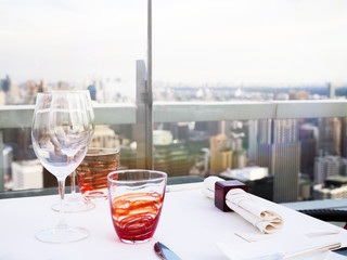 Table setting at rooftop bar, skyscraper restaurant view