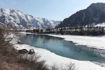 Ice melting in the river in early spring, Katun River, Altai, Russia