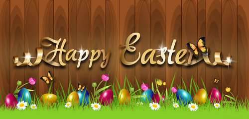 Easter greeting card with colorful easter eggs in grass