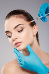 Cute girl doing beauty procedures at clinic