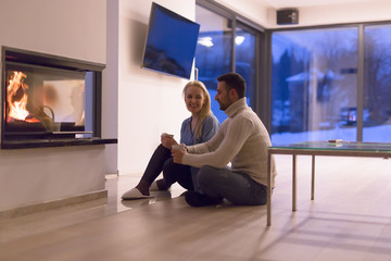 happy couple in front of fireplace