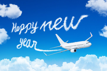 Happy New year concept. Drawing by airplane vapor contrail in sky.