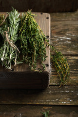Rosemary and thyme on wood crate