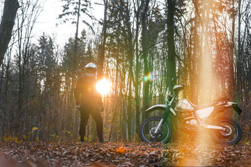 travel motorcycle off road Motorcyclist gear, A motorcycle driver looks in autumn forest, adventure concept, active lifestyle, enduro, end of season, dual sport, touring, cold weather, fog, helmet