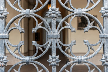 Beautiful iron grating fence in the city