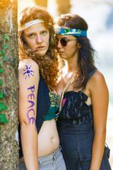 Cute free hippie girls. Free love. - Vintage effect photo
