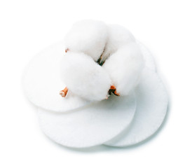Fluffy cotton pads with cotton flower on a white background