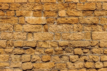 Antique yellow brick stone texture.