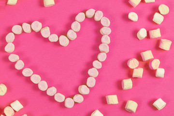 marshmallow sweets placed in heart shape.valentine's day and love concept on pink background