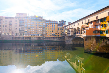 famous ponte vecchio bridge of florence on sunny day