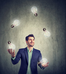 Man juggling with light bulbs