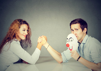 Man and woman having arm wrestling