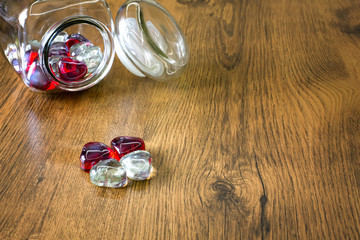 Valentines love concept: Glass hearts symbolize Love on wooden background. Top view. Macro, close up.