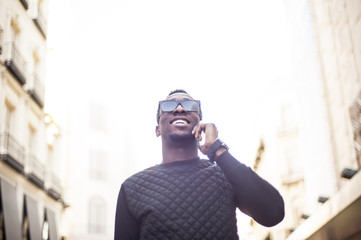 attractive african man using telephone