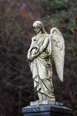 Statue of mourning angel in some lithuanian cemetery