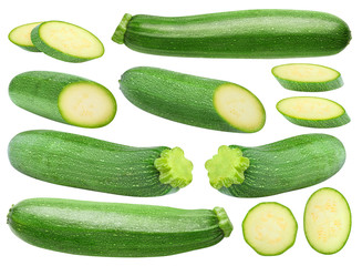 Isolated zucchini. Collection of whole and cut zucchini fruits isolated on white background with clipping path