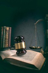 law theme, mallet of the judge, justice scale, old books, wooden desk
