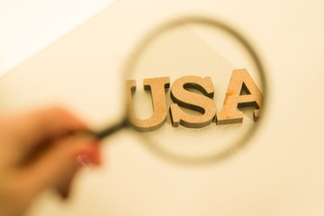 Magnifying glass on white background with the word USA