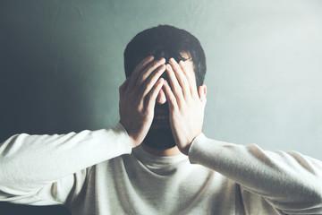 Depressed man hand face