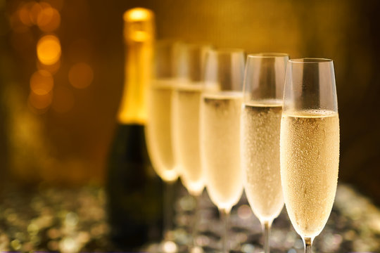 Many glasses of champagne in a line. Selective focus