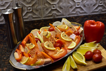Raw salmon with vegetables prepared for baking.