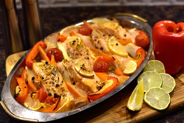 Baked salmon with vegetables.
