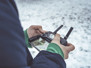 close up shot of person control the aerial drone with joystick