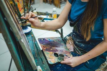 Ginger female painter at work