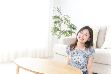 Young woman alone being relaxed at home