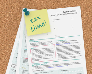 note with tax time text and tax form