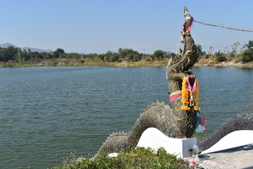 Praya Nakha image state on the bank of the river