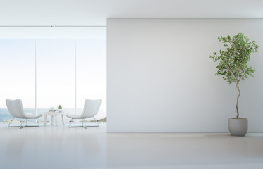 Indoor plant on white floor with empty concrete wall background, Lounge and coffee table near glass window in sea view living room of modern luxury beach house or hotel - Home interior 3d illustration Fotoväggar