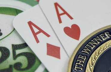 Poker chips and card with gold Champion of Poker coin