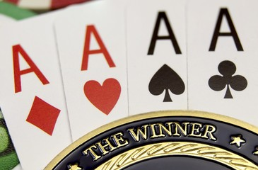 Poker card and golden chip The Winner label