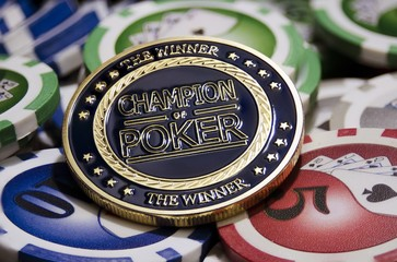 Poker chips and golden chip with label Champion of poker