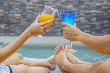 Happy couple with two glasses of orange juice.
