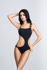 Fit, healthy and sporty woman in swimsuit. Sport, fitness, diet and healthcare concept.