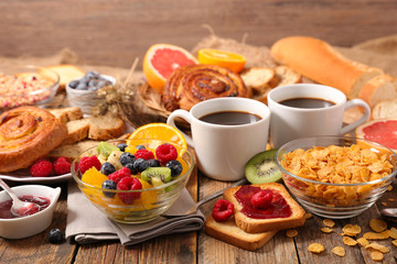 breakfast with fruit,cornflakes,coffee cup