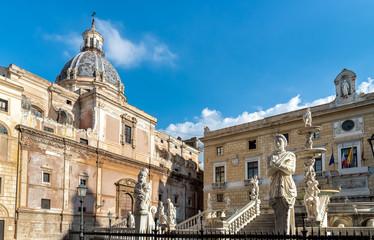 View of Santa Caterina church dome with statue of the Pretoria fountain ahead in Palermo, Sicily, Italy