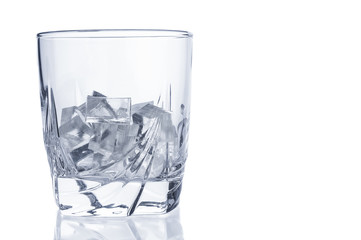 Glass with ice cubes closeup isolated on white background